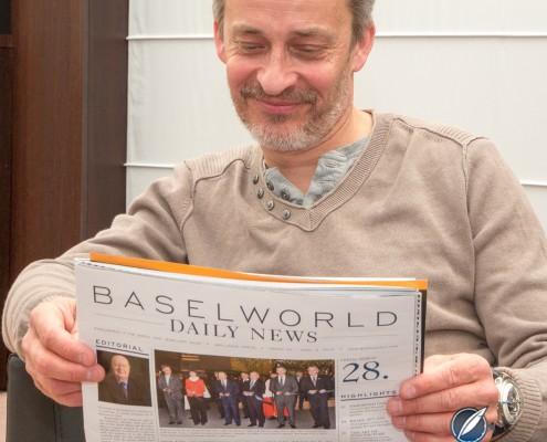 Vianney Halter reading the Baselworld News wearing his Deep Space Tourbillon