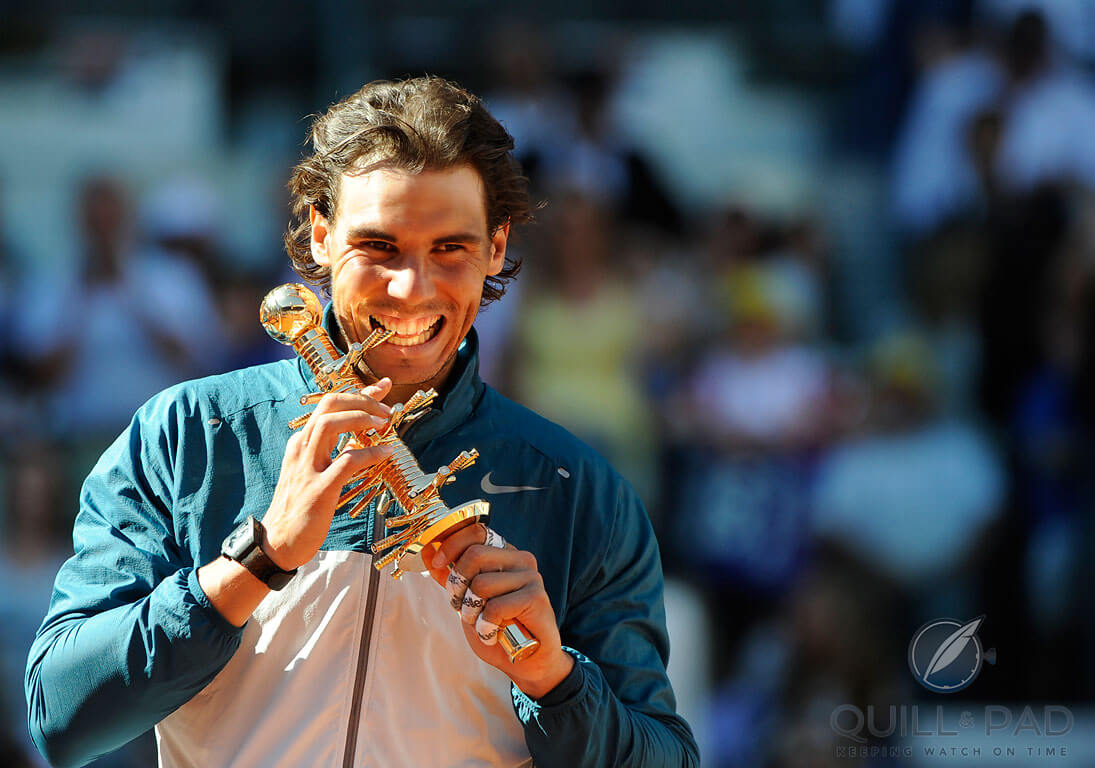 A very pleased Rafael Nadal with the Ion Tiriac Trophy after winning the 2014 Mutua Madrid Open . Phozo courtesy ATP