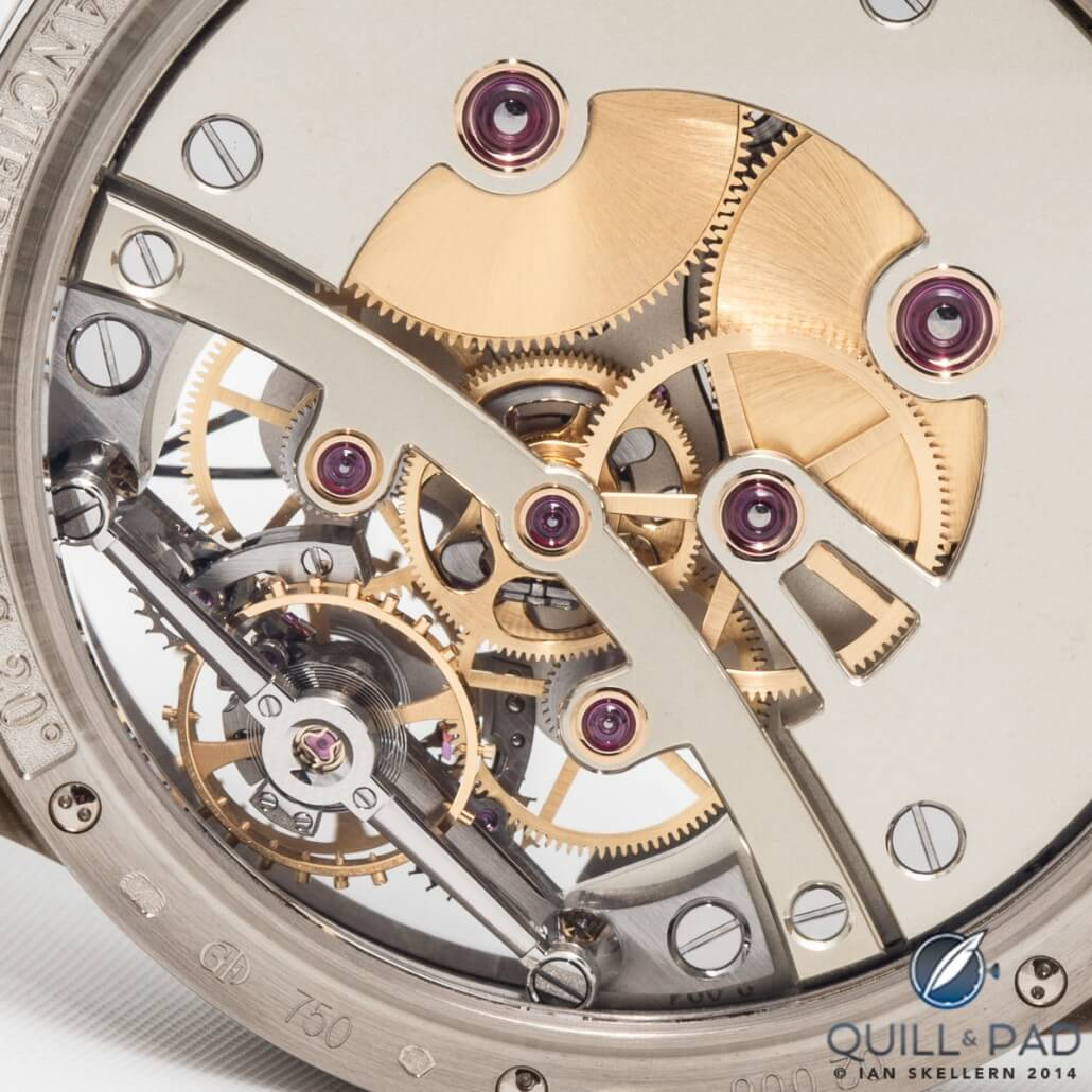 Flat polished screw heads with polished bevels and countersinks visible through the display back of this Greubel Forsey Double Balancier