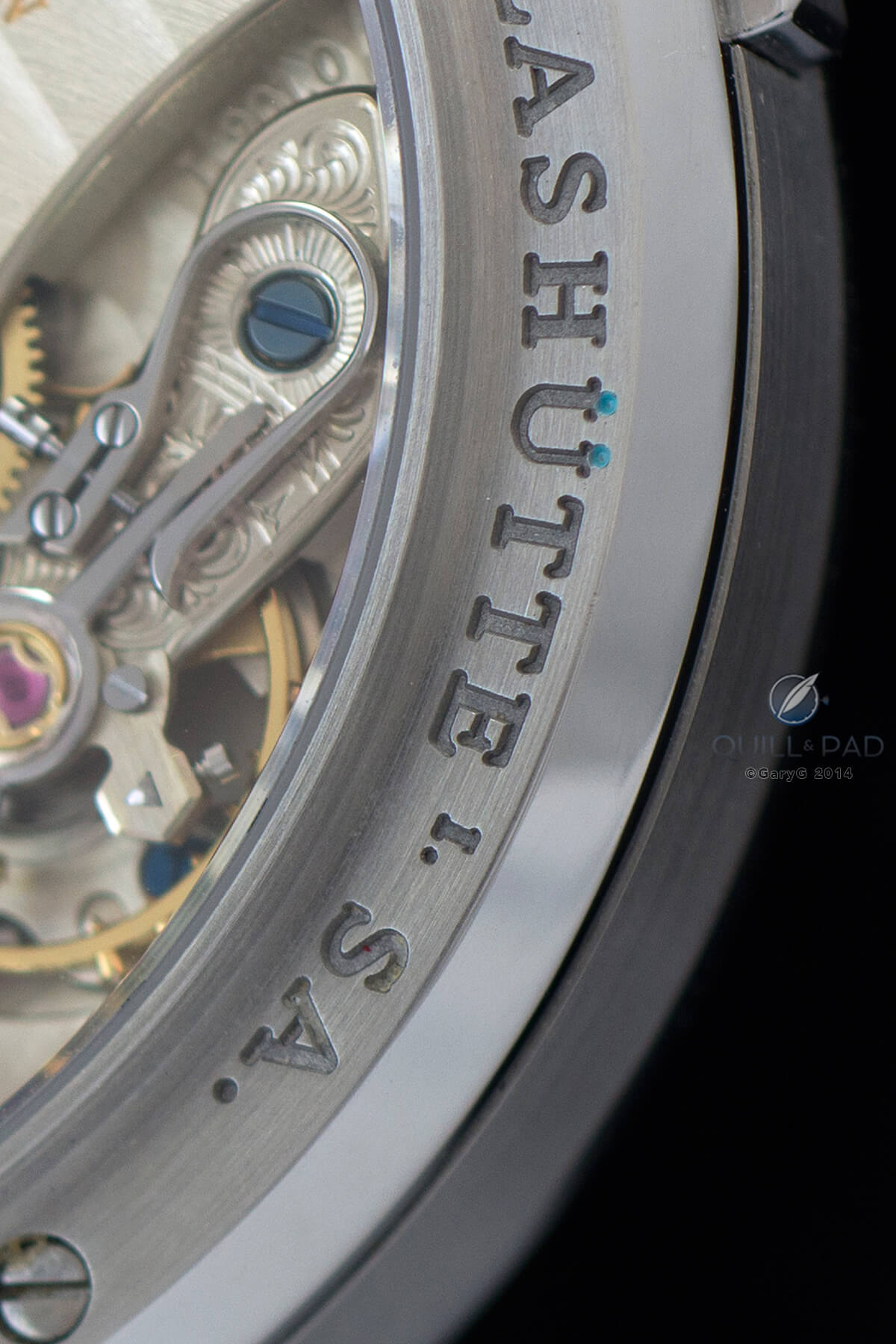 Mysterious blue/green dots on the A. Lange & Söhne Lange 1 in stainless steel