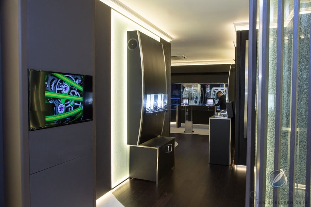 Inside London's Richard Mille boutique looking toward the front; note the curved shape of the display cases