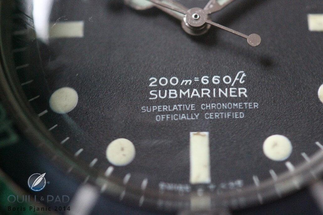 A close shot of the Rolex Submariner 5512 focusing on the four lines of pad-printed text