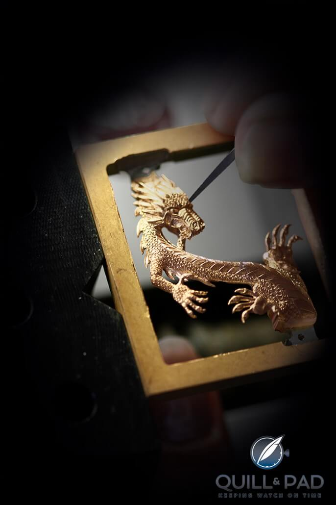 Carefully engraving a gold Corum dragon