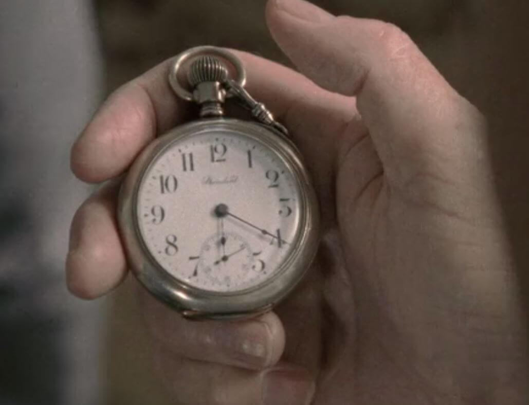 Herschel Greene (Scott Wilson) gives Glenn Rhee (Steven Yeun) his prized pocket watch in 'The Walking Dead'