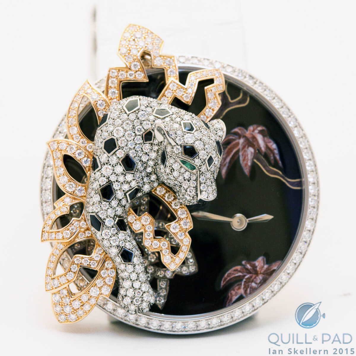 The removable panther on this jewelry timepiece boasts Cartier's version of snow setting