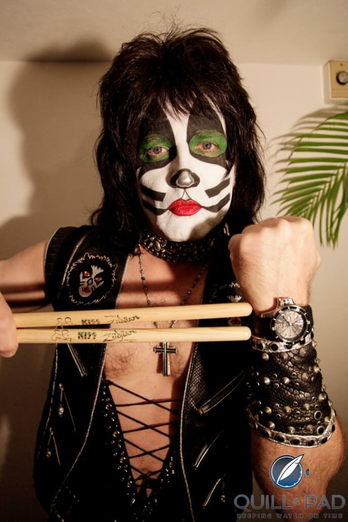 Eric Singer in Kiss catman makeup wearing a Ball watch