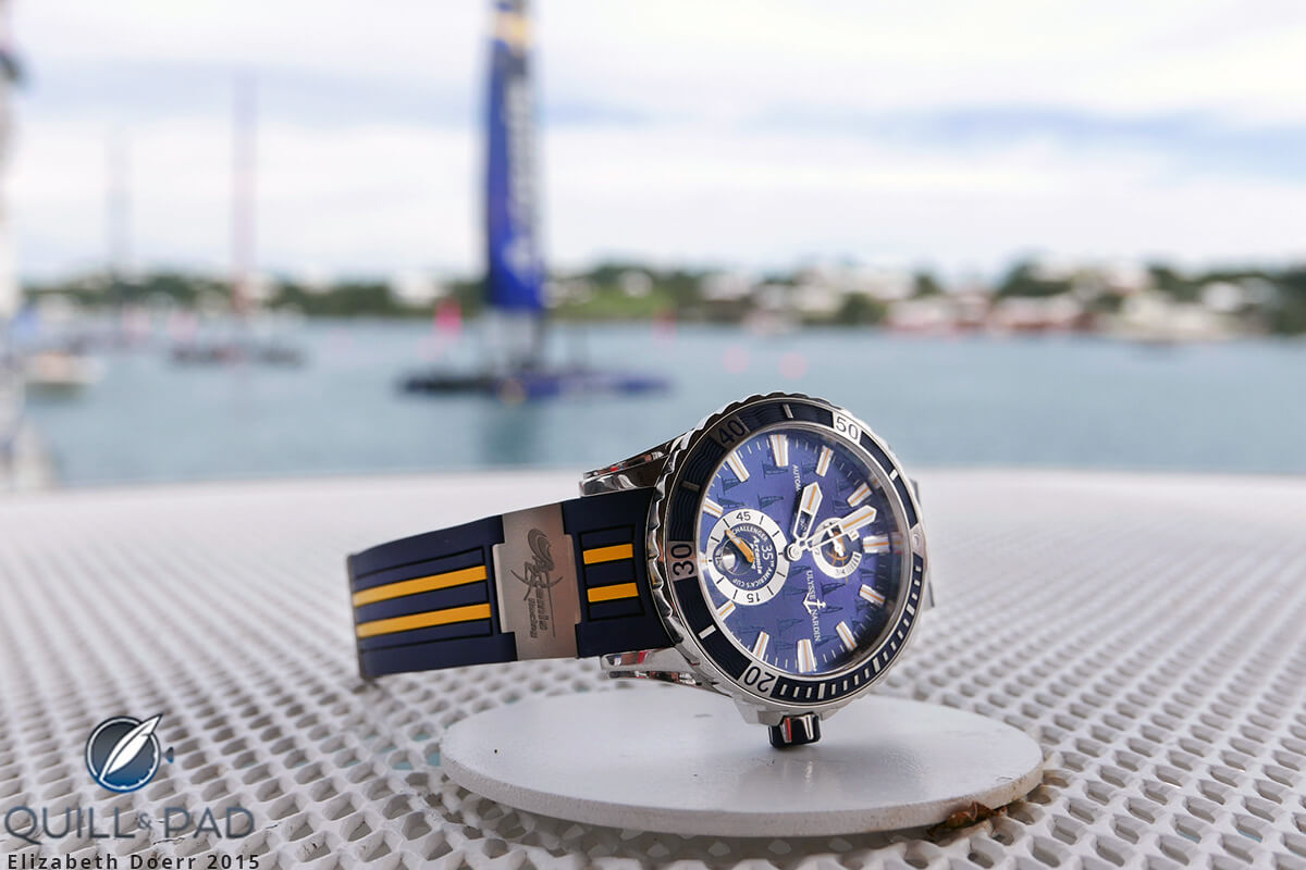 The Ulysse Nardin Marine Diver Artemis Racing in Bermuda with boats racing in the America's Cup in the background