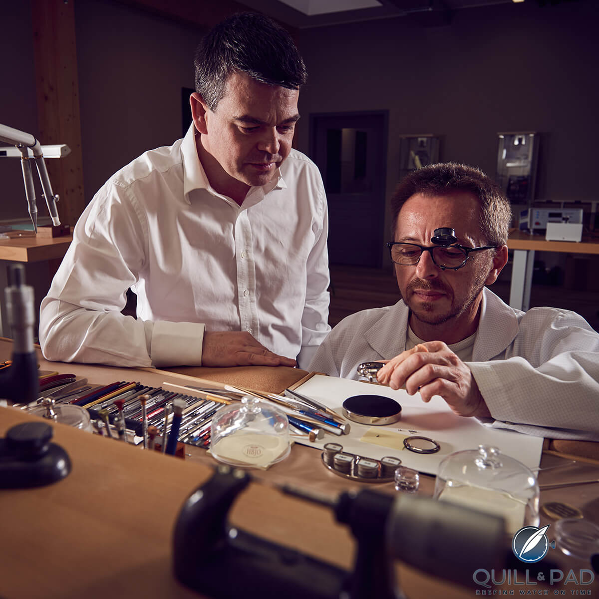 Romain Gauthier (left) and watchmaker Patrick Martin in the brands' atelier in Le Sentier