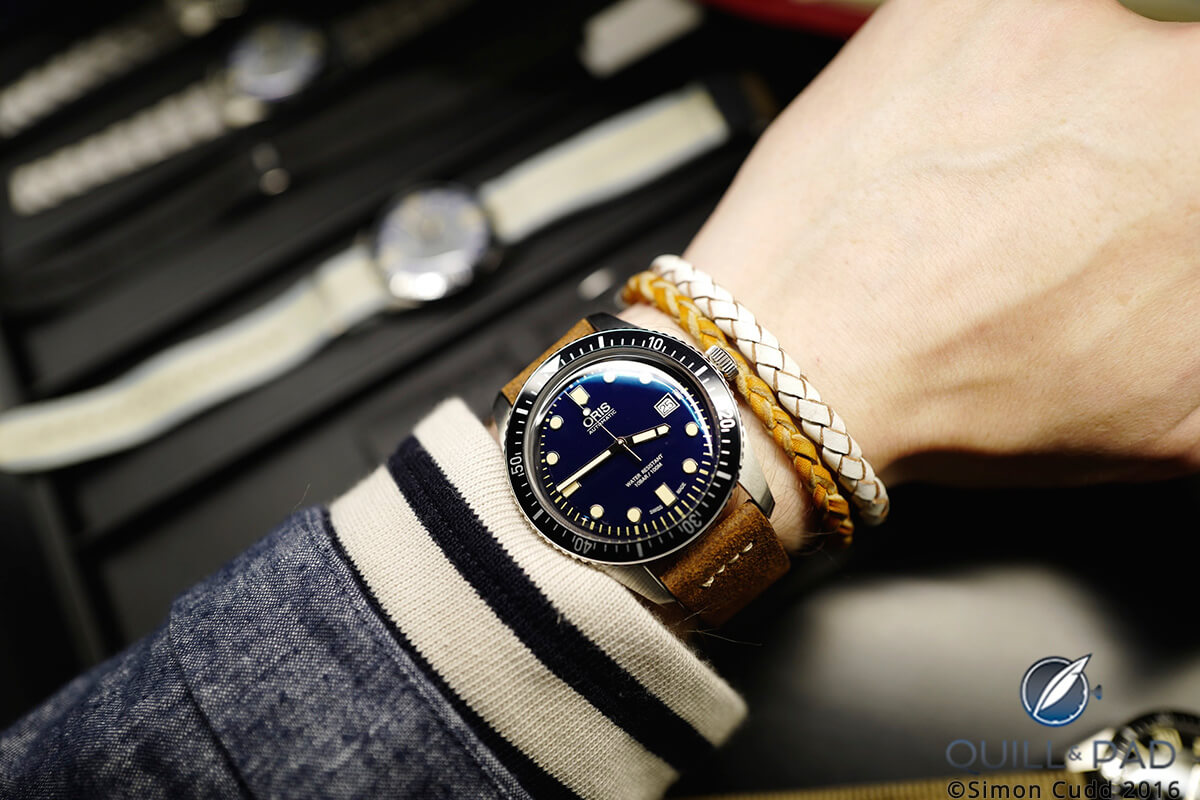 The Oris Divers Sixty-Five on a stunning brown vintage-style leather strap