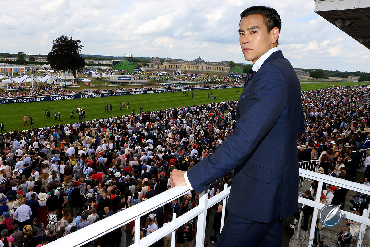 Eddie Peng overlooks the grounds of the Prix de Diane 2016 with Château de Chantilly in the background