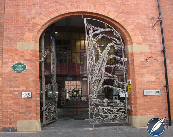 Tree motif on the door at the entrance to the Yard-O-Led factory in Birmingham, England