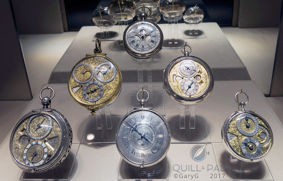 Display of antique watches including at center rear the earliest perpetual calendar, Thomas Mudge, 1762