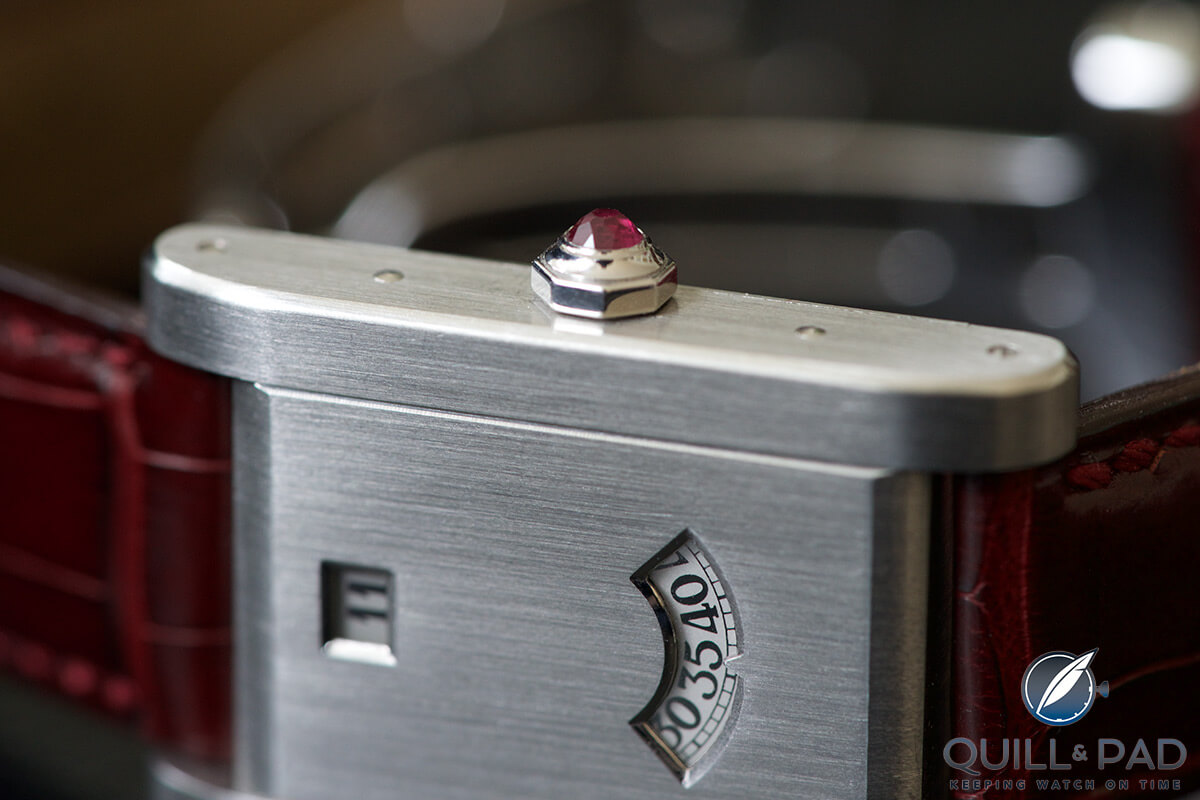 Ruby cabochon in the crown of the Tank à Guichets in platinum