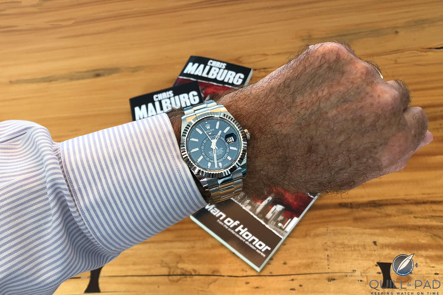 Rolex Sky-Dweller on the author's wrist with second time zone set to his next assignment in Bora Bora