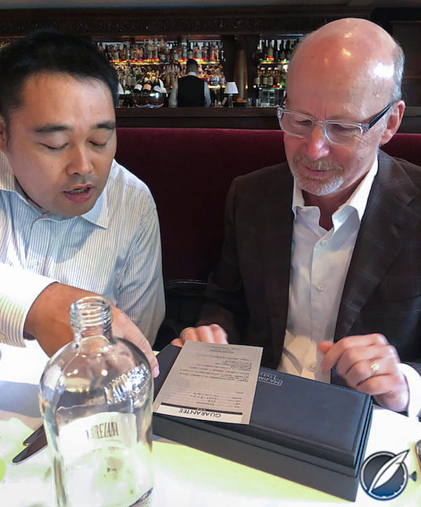 Noritake Sakurai reviews the Tsunami's warranty with GaryG (photo courtesy AllenS)