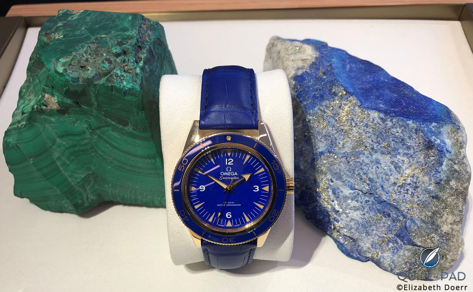 A 2019 Omega Seamaster between malachite (left) and lapis lazuli